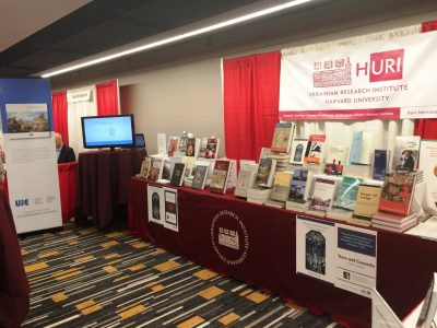 Books from partner organizations are displayed at the Harvard Ukrainian Research Institute's booth at the 2018 ASEEES convention.