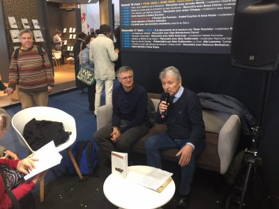 "The Ukraine country stand offered two interesting talks by French writers on Ukrainian-Jewish topics. Borys Czerny (left) and Lubomir Hosejko (right) discuss Czerny's book ""Recits et contes juifs et ukrainiens du pay houtsoule""."