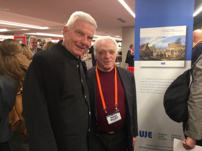 "UJE board member Paul Robert Magocsi (left) and UJE board member Berel Rodal stand before a banner promoting the book ""A Journey Through the Ukrainian-Jewish Encounter: From Antiquity to 1914."""