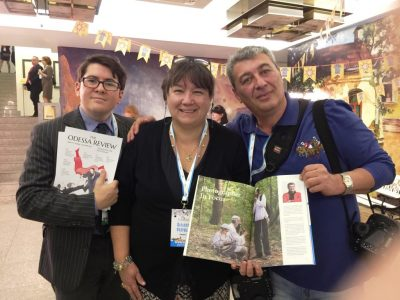 Vlad Davidzon, Chief Editor of The Odessa Review (left), Natalia A. Feduschak, UJE Director of Communications (middle), and Odessa-born photographer Boris Bukhman (right), with a special issue of The Odessa Review dedicated to Ukrainian-Jewish relations.