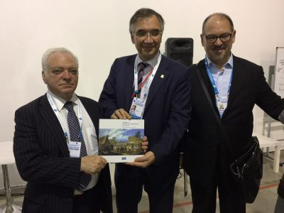 "Roman Waschuk, Canada's Ambassador to Ukraine (middle) receives a copy of the catalogue ""A Journey Through the Ukrainian-Jewish Encounter: From Antiquity to 1914"". With Berel Rodal, Board Member, Ukrainian Jewish Encounter (left) and Adrian Karatnycky, Co-Director, Ukrainian Jewish Encounter, (right)."