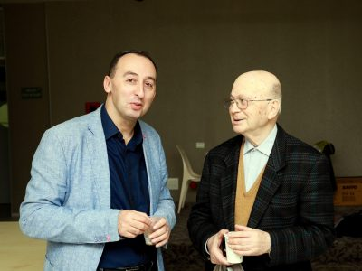 Shimon Briman (left) and UJE Board Member Wolf Moskovich (right).