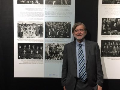 Mark Freiman, Board Member of Ukrainian Jewish Encounter, stands next to a panel that describes Jewish life in Sambir before the Holocaust. Mr. Freiman's family roots are in Sambir.