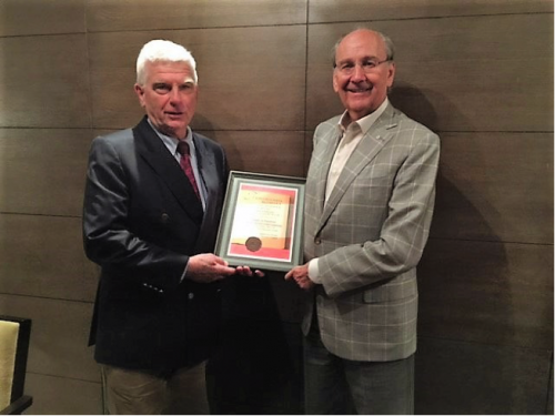 Prof. Paul Robert Magocsi (left) presents the Lviv Book Forum Award to UJE Board chairman James C. Temerty (right) at a special ceremony in Kyiv.