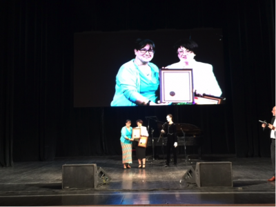 "Natalia Feduschak of UJE receiving an award from Lviv Book Forum's Oleksandra Koval on behalf of ""Jews and Ukrainians: A Millennium of Co-Existence"