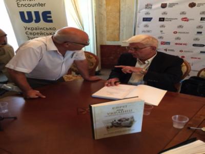 Professor Paul Robert Magocsi signing copies of Jews and Ukrainians: A Millennium of Co-Existence